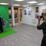 Annabel McCourt photographing local people for the St James' Square artwork