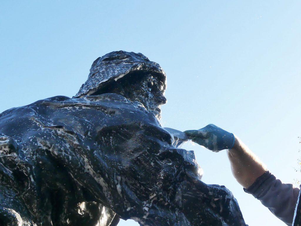 Trevor Harries cleaning the Fishermen's Memorial statue